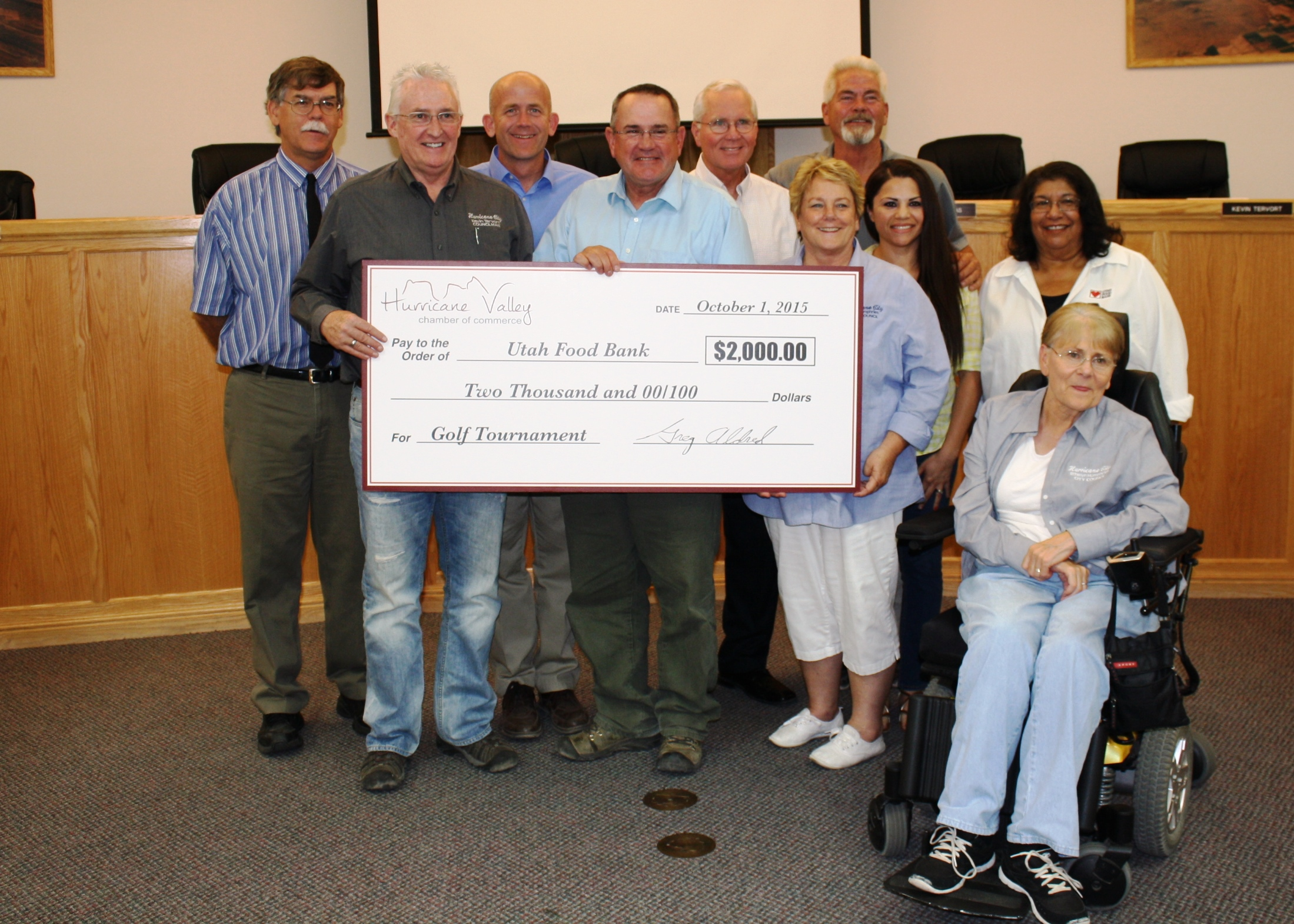 Mayor John Bramall (center), Hurricane City Council members and Hurricane Valley Chamber of Commerce members pose with a $2,000 check for the Utah Food Bank, Hurricane City Council Chambers, Hurricane, Utah, Oct. 1, 2015| Photo by Reuben Wadsworth, St. George News