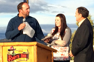 """Ruby's Inn General Manager of Operations Lance Syrett and Garfield County Office of Tourism General Manager Falyn Owens present the governor with a petrified """"bee or wasp hive"""" from the area to add to the governors collection of gifts, Bryce Canyon National Park, Bryce, Utah, Oct. 7, 2015 