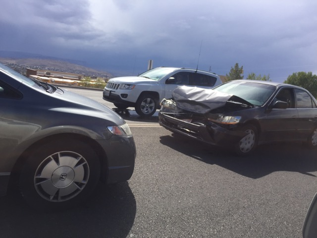 The damage to a gray Honda Accord after police say it rear-ended a minivan stopped at a red light, St. George Blvd., St. George, Utah, Oct. 5, 2015 | Photo courtesy of Abraham Palmer, St. George News