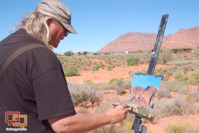 "Brad Holt of Mission Gallery creates a landscape painting inspired by the majestic scenery at the ""Art in Kayenta"" festival, Ivins, Utah, Oct. 9, 2015 
