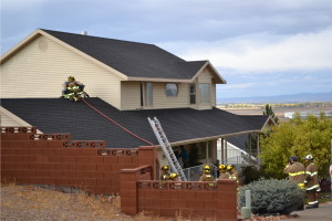 Firefighters saw through the roof after lightning struck, starting a small fire above the garage, Cedar City, Utah, Oct. 18, 2015 | Photo by Emily Hammer, St. George News
