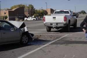 18-year-old driver rear ended a Forrest Service truck at a red light totaling her car, Main Street, Cedar City, Utah, Oct. 23, 2015 | Photo by Carin Miller, St. George News
