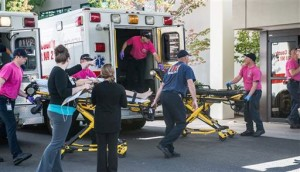 A patient is wheeled into the emergency room at Mercy Medical Center in Roseburg, Ore., following a deadly shooting at Umpqua Community College, in Roseburg, Thursday, Oct. 1, 2015. | Photo by Aaron Yost, Roseburg News-Review via AP, St. George News
