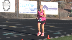 World Record Holder, 90-year-old Dottie Gray runs along the track during the 1,500 meter run event at the 2015 Huntsman Senior Games, St. George, Utah, Oct. 7, 2015 | Photo by Devan Chavez, St. George News