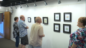 Exhibit visitors take a moment to ponder some of Gubler's paintings at the DiFiore Center, St. George, Utah, Oct. 2, 2015 | Photo by Sheldon Demke, St. George News
