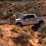 A Washington County Sheriff's deputy got his patrol truck stuck while responding to a call in the Desert Reserve, Washington County, Utah, Oct. 11, 2015 | Photo courtesy of Washington County Sheriff Search and Rescue, St. George News