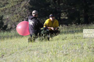 Prior to starting firing operations, North Zone fire effects crew monitors prepare a balloon for a PIBAL operation during Moquitch 4 prescribed fire, June 22, 2015, Southwestern Region, Kaibab National Forest | Photo courtesy of the U.S. Forest Service, David Hercher, St. George News