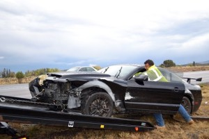 A vehicle is towed from the scene of an accident on I-15 near Cedar City Sunday, Cedar City, Utah, Oct. 18, 2015 | Photo by Emily Hammer, St. George News