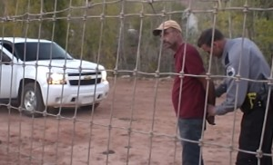A member of the Hildale-Colorado City Marshal's Office places Andrew Chatwin under arrest, Colorado City, Arizona, Oct. 13, 2015 | Video screenshot image, courtesy of Isaac Wyler, St. George News