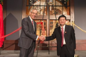 SUU President Scott Wyatt and Hunan Normal University President Jiang Hongxin shake hands after tying a ribbon together, symbolizing the bringing together of two cultures, as part of the Confucius Institute opening celebration, Cedar City, Utah, Sept. 28, 2015 | Photo courtesy of Southern Utah University, St. George News