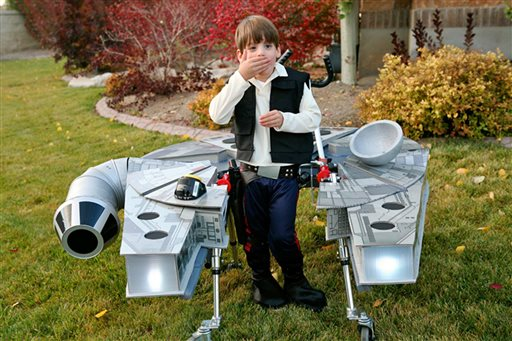 "Sebastian Bailey, 5, who has cerebral palsy, stands in his Halloween costume dressed as Han Solo aboard the Millennium Falcon from the original ""Star Wars"" movies. Sandy, Utah, Oct. 27, 2015 