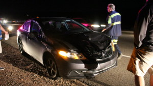 St. George Police officers and other responders went the scene of a deer versus car incident on Red Hills Parkway. While the driver was unharmed, his car was damaged and the deer involved was killed, St. George, Utah, Oct. 30, 2015 | Photo by Mori Kessler, St. George News