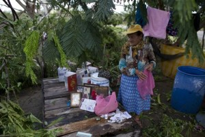 Maria del Refugio Ruiz Bravo sets out to dry personal belongings soaked by Hurricane Patricia, in La Fortuna, Mexico. Record-breaking Patricia pushed rapidly inland over mountainous western Mexico early Saturday, weakening to tropical storm force while dumping torrential rains that authorities warned could cause deadly floods and mudslides, La Fortuna, Mexico, Oct. 24, 2015 | AP Photo/Rebecca Blackwell, St. George, News