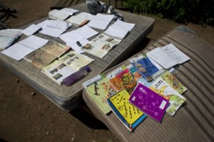 School books are laid out to dry on top of mattresses recovered from a home destroyed by Hurricane Patricia, in Chamela, Mexico. Record-breaking Patricia pushed rapidly inland over mountainous western Mexico early Saturday, weakening to tropical storm force while dumping torrential rains that authorities warned could cause deadly floods and mudslides. Chamela, Mexico, Oct. 24, 2015 | AP Photo/Rebecca Blackwell, St. George News