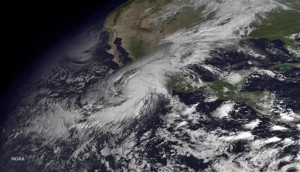 """This satellite image taken at 10:45 a.m. EDT on Friday, Oct. 23, 2015, and released by the National Oceanic and Atmospheric Administration shows Hurricane Patricia moving over Mexico's Pacific Coast. Hurricane Patricia headed toward southwestern Mexico Friday as a monster Category 5 storm, the strongest ever in the Western Hemisphere that forecasters said could make a """"potentially catastrophic landfall"""" later in the day.   Image courtesy of National Oceanic and Atmospheric Administration via AP, St. George News"""
