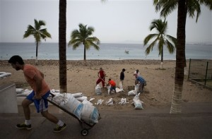 """Residents prepare for the arrival of Hurricane Patricia filling sand bags to protect beachfront businesses in Puerto Vallarta, Mexico. Patricia barreled toward southwestern Mexico Friday as a monster Category 5 storm, the strongest ever in the Western Hemisphere. Locals and tourists were either hunkering down or trying to make last-minute escapes ahead of what forecasters called a """"potentially catastrophic landfall"""" later in the day, Puerto Vallarta, Mexico Oct. 23, 2015   AP Photo/Rebecca Blackwell, St. George News"""