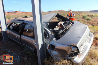 A passenger car came to rest against a highway sign after being forced off the road Wednesday morning, Washington, Utah, Oct. 7, 2015   Photo by Ric Wayman, St. George News