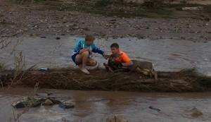 (L-R) Ethan and Braxen Glines with the deer they pulled from the Virgin River, St. George, Utah, October 2015 | Photo by Tiffany Defa, St. George News