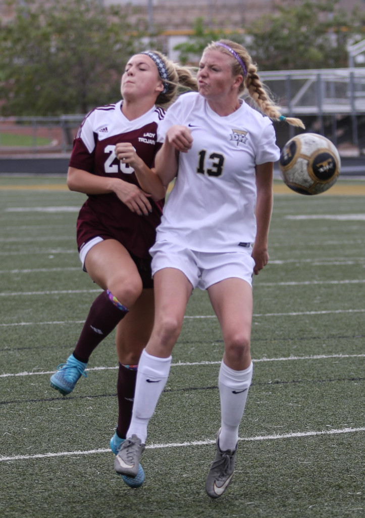 Kenadee Stout (20) for Morgan and Jess Mathis (13) for Desert Hills, Desert Hills vs Morgan, Girls Soccer,St George, Utah, Oct. 17, 2015, | Photo by Kevin Luthy, St. George News.