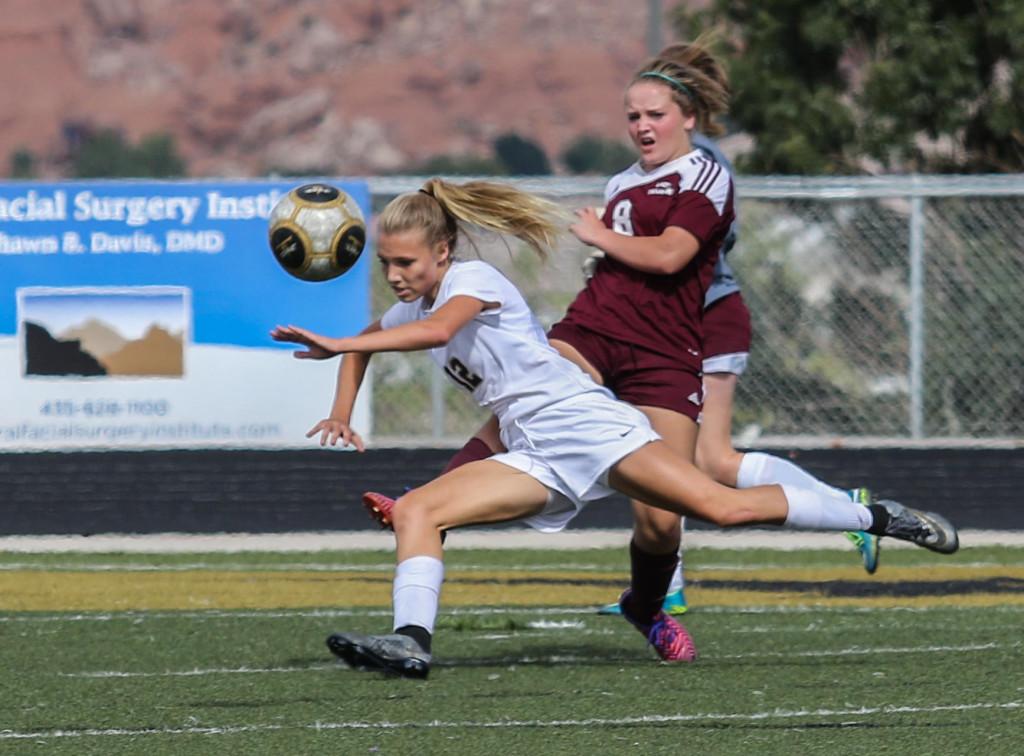 Brooklyn Lott (12) for Desert Hills and Talli Gardner (8) for Morgan, Desert Hills vs Morgan, Girls Soccer,St George, Utah, Oct. 17, 2015, | Photo by Kevin Luthy, St. George News.