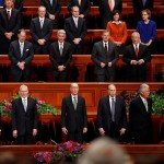 "Church leaders stand and sing with the congregation the hymn ""We Thank Thee, O God, for a Prophet"" during the Saturday morning session of general conference, Salt Lake City, Utah, Oct. 3, 2015 