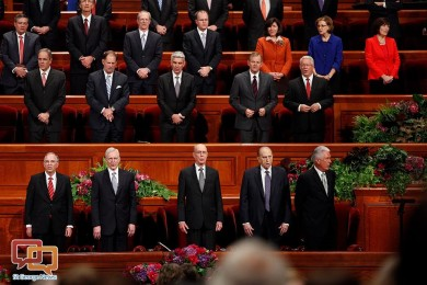 """Church leaders stand and sing with the congregation the hymn """"We Thank Thee, O God, for a Prophet"""" during the Saturday morning session of general conference, Salt Lake City, Utah, Oct. 3, 2015 
