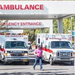 Paramedics return to their ambulances after delivering patients to Mercy Medical Center in Roseburg, Ore., following a deadly shooting at Umpqua Community College, in Roseburg, Thursday, Oct. 1, 2015.  | Photo by Aaron Yost, Roseburg News-Review via AP, St. George News
