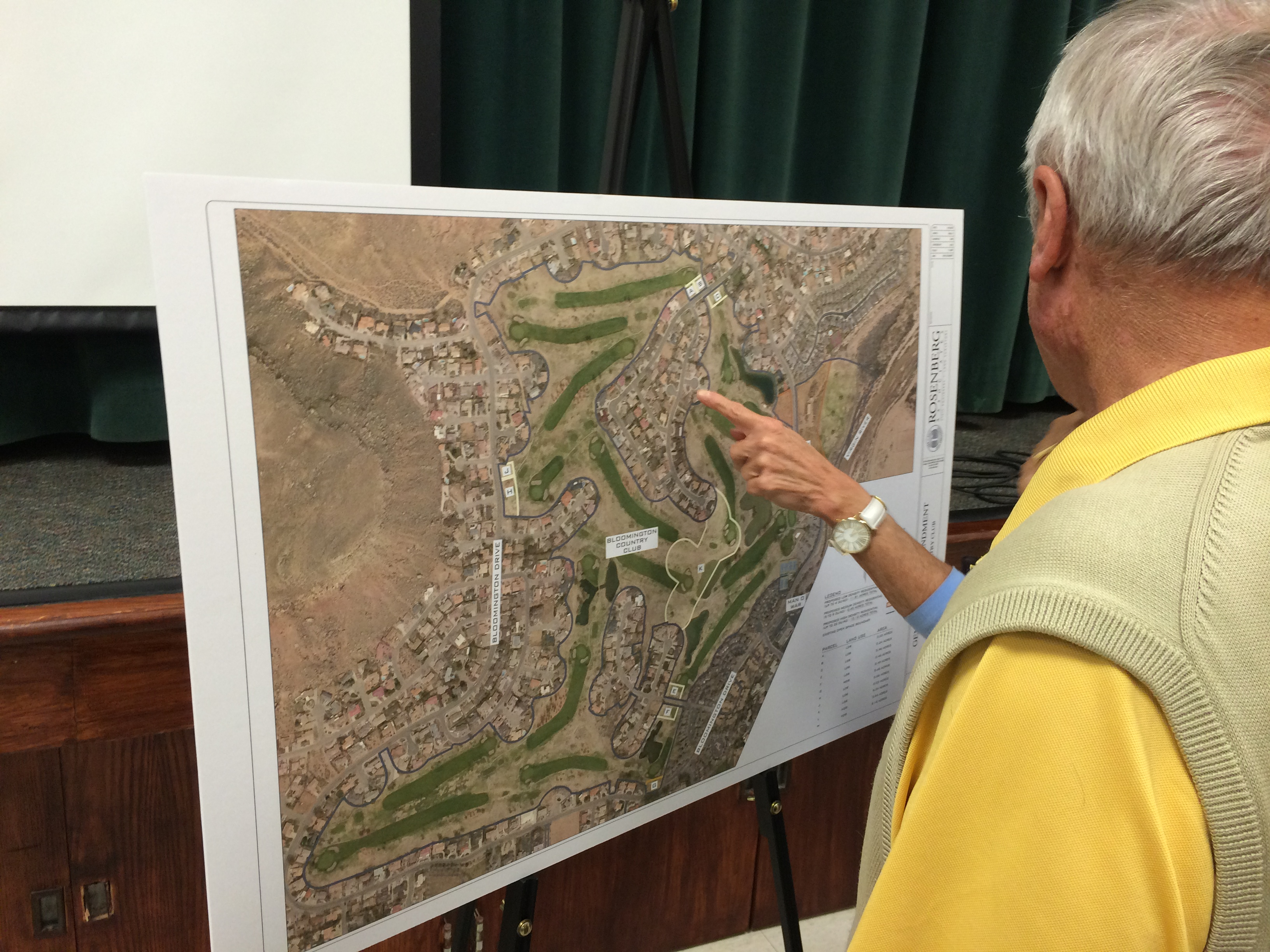 Residents of the Bloomington community  look at diagrams of proposed general plan amendments to allow additional residential housing appurtenant to Bloomington Country Club, presented by Developer Darcy Stewart at a community meeting at Bloomington Elementary School in St. George, Utah, Oct. 1, 2015 | Photo by JJ Deforest, St. George News
