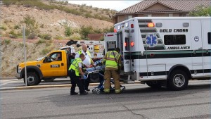 A driver of a Ford Explorer involved in an accident Tuesday is loaded into an ambulance, St. George, Utah, Oct. 27, 2015 | Photo by Ric Wayman, St. George News