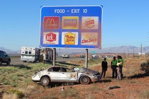 A passenger car came to rest against a highway sign after being forced off the road Wednesday morning, Washington, Utah, October 7, 2015 | Photo by Ric Wayman, St. George News