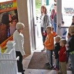 Gail Bunker welcomes the first visitors to the St. George Children's Museum: Denae Syphus and her three children, Awnan, 9, Anneke, 7, and Finnian, 5, of Ft. Hood, Texas, St. George, Utah, Nov. 21, 2013 | Photo by John Teas, St. George News