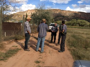 From left, Andrew Chatwin and Patrick Pipkin speak with Hildale-Colorado City Marshal's Office responder and a deputy from the Mohave County Sheriff's Office, Colorado City, Arizona, Oct. 18, 2015 | Photo by Cami Cox Jim, St. George News