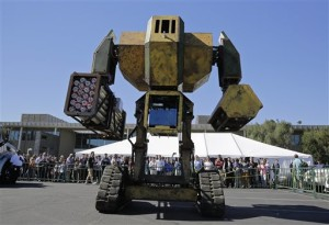 Acrowd of people watch the MegaBots 15-foot tall, piloted Mk.II robot in action at the Pioneer Summit in Redwood City, Calif. Let the giant robot wars begin. A team of American engineers challenged a group in Japan to a battle for robot supremacy, and the Japanese said bring it on. So Oakland-based MegaBots has launched a Kickstarter campaign to raise money to turn the Mk.II, into a real fighting machine, ready for hand-to-hand combat, Oct. 9, 2015 | AP Photo by Eric Risberg, St. George News