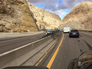 About 300 feet of glare screen that sits on top of the barrier median wall was knocked off when a UPS triple-unit semitrailer toppled its third trailer on Interstate 15 in the Virgin River Gorge. Mohave County, Arizona, Nov. 10, 2015 | Photo courtesy of Travis Hill, St. George News