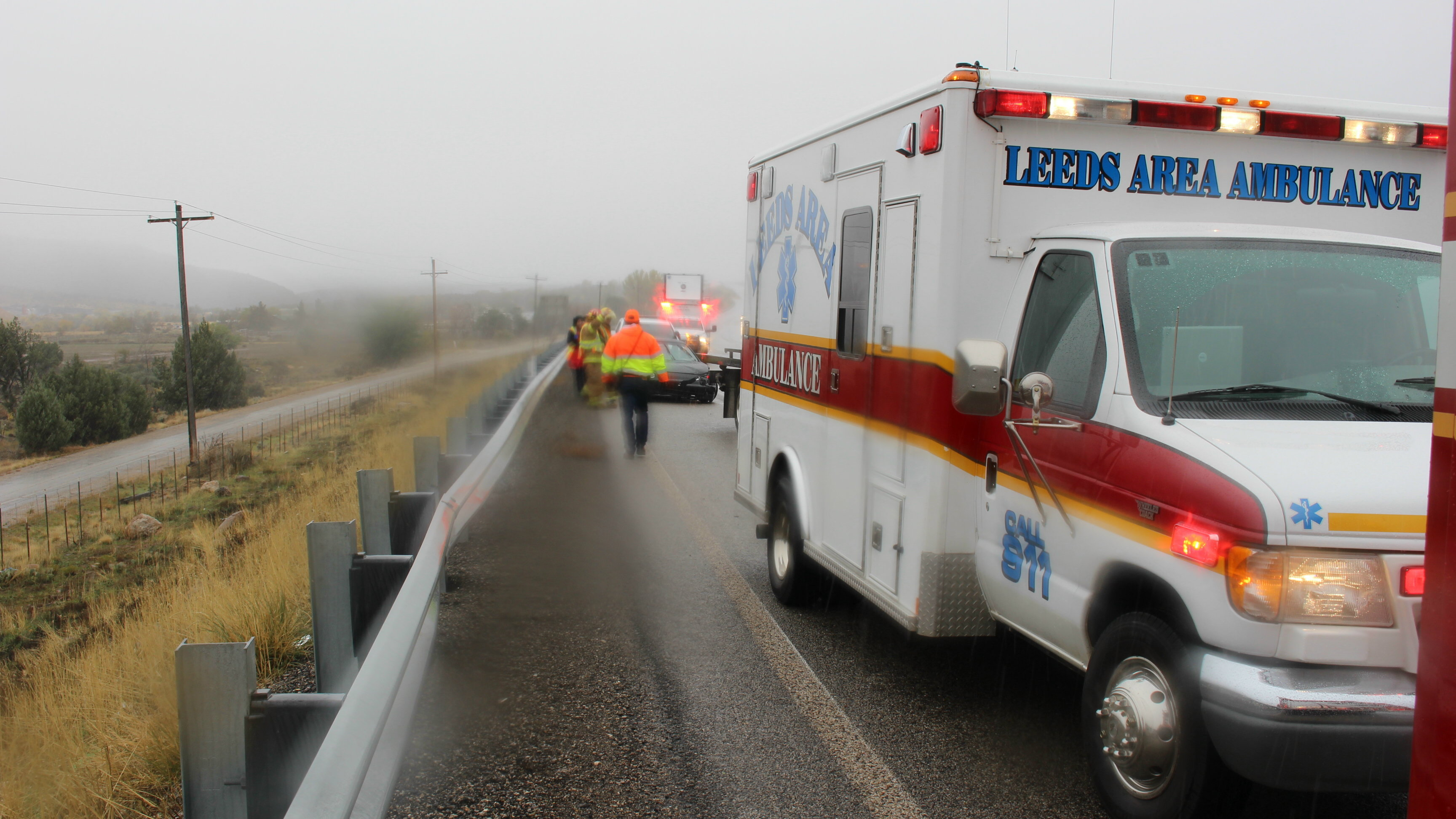 Speed mixed with less-than-ideal road conditions are considered to be contributing factors in a car-versus-semi accident on northbound I-15 near milepost 32. The roadway was slick due to a mix of rain and snowfall, Washington County, Utah, Nov. 16, 2015 | Photo by Mori Kessler, St. George News