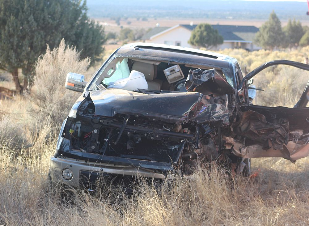 A wrecked Ford F-150 sits along the side of state Route 59 after a pileup involving several vehicles Friday, with eight people transported to the hospital with injuries. Apple Valley, Utah, Nov. 27, 2015   Photo by Ric Wayman, St. George News