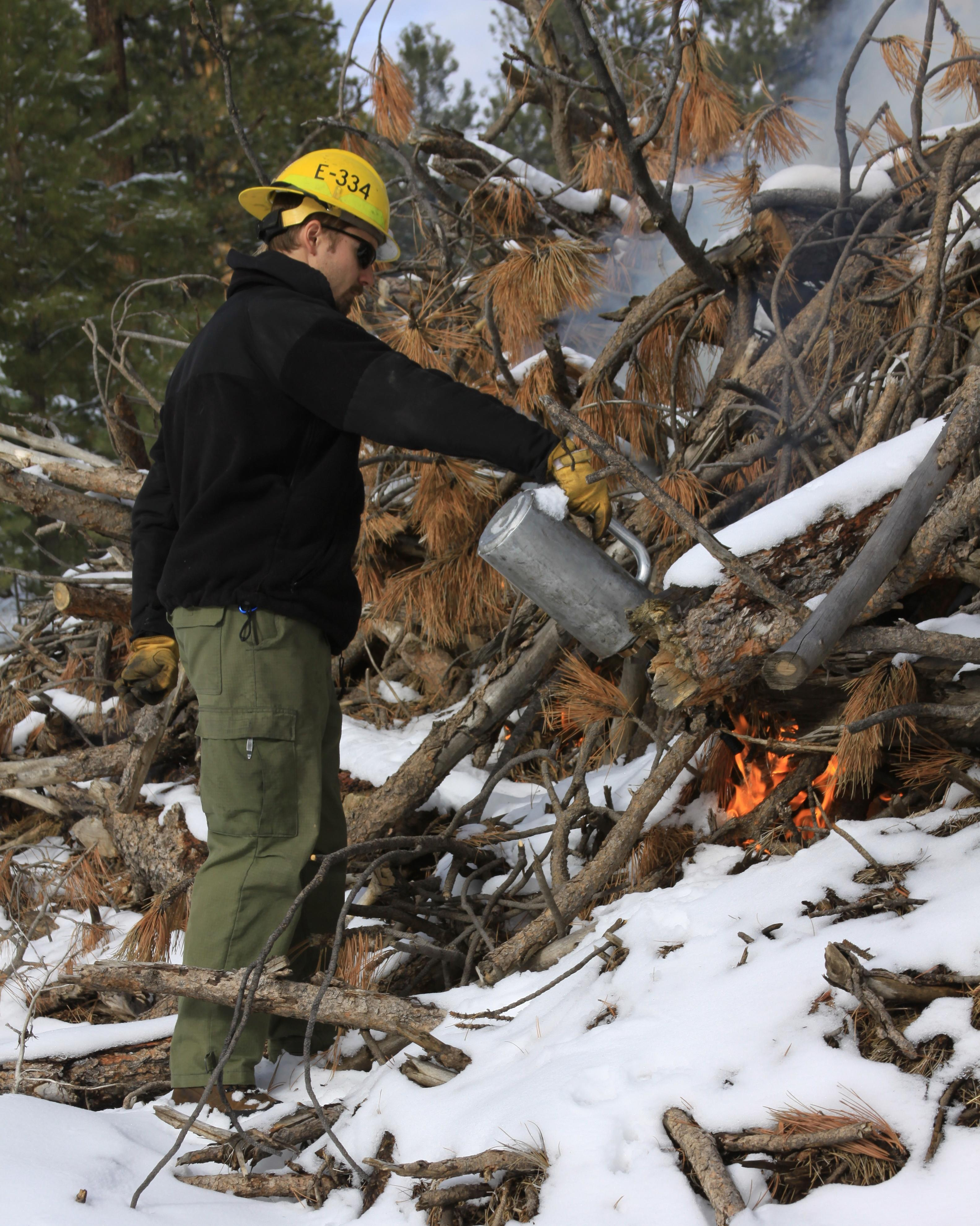 A North Zone wildland fire fighter ignites a pile last winter in the Jacob Lake Admin Complex. Credit the U.S. Forest Service, Southwestern Region, Kaibab National Forest, circa Nov. 23, 2015 | Photo courtesy of U.S. Forest Service, St. George News