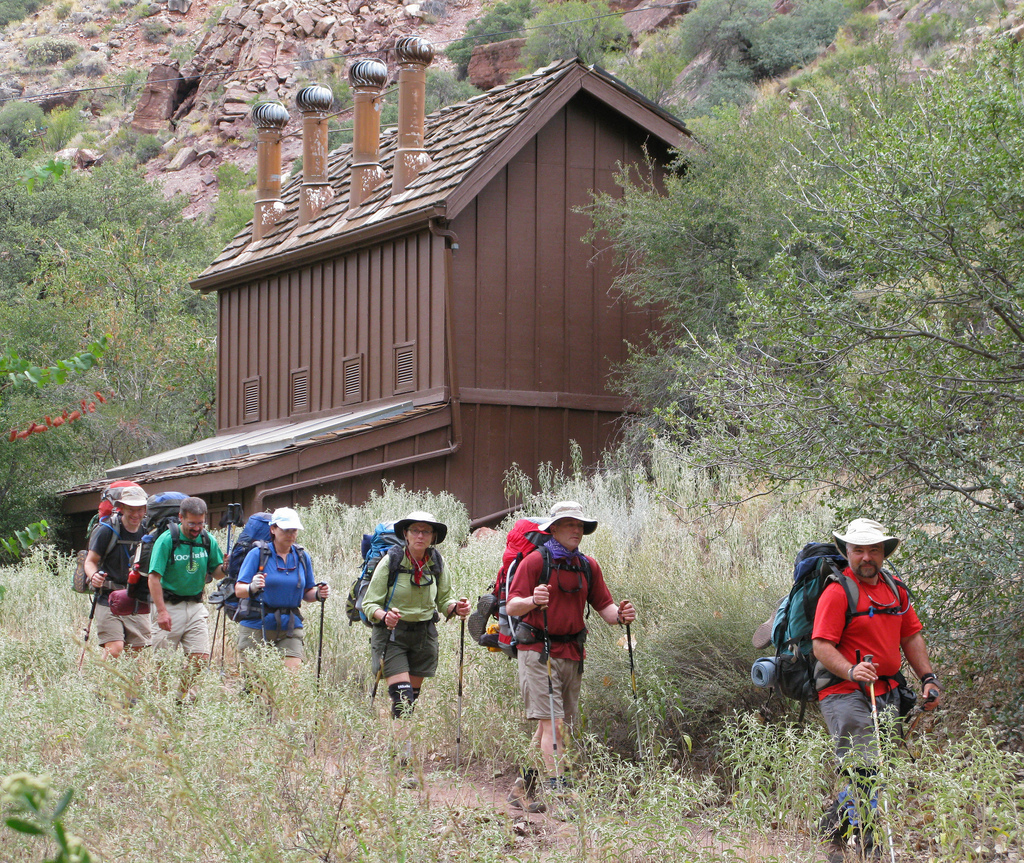 This 2008 photo shows a backpacking party passing by the Cottonwood Campground restrooms on the North Kaibab Trail, Grand Canyon National Park. Cottonwood Campground is a small campground 6.8 miles below the North Rim of the Grand Canyon on the North Kaibab Trail. To camp in this campground you must obtain a backcountry permit. Cottonwood Campground, Grand Canyon National Park, Arizona, Oct. 3, 2008 | Photo courtesy of the National Park Service, St. George News