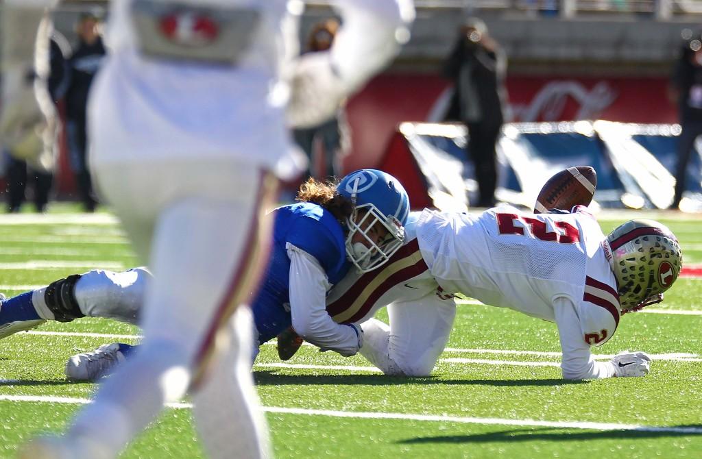 Logan's Spencer Corbett (2) fumbles the ball, Dixie vs. Logan, 3AA State Football Championship, Salt Lake City, Utah, Nov. 20th, 2015, | Photo by Robert Hoppie, ASPpix.com, St. George News