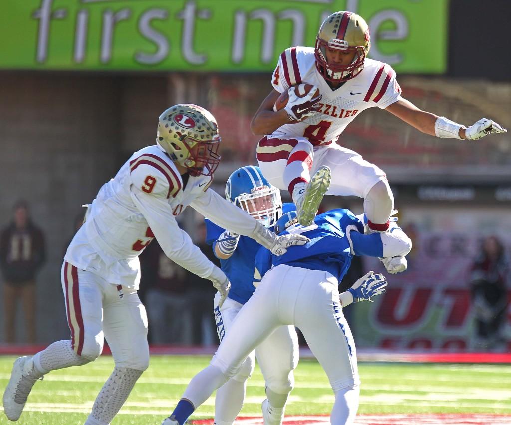 Logan's Hartman Rector (4) leaps over a Dixie defender, Dixie vs. Logan, 3AA State Football Championship, Salt Lake City, Utah, Nov. 20th, 2015, | Photo by Robert Hoppie, ASPpix.com, St. George News
