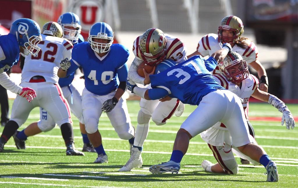 Dixie's  Malakai Fakahua (37) makes a tackle, Dixie vs. Logan, 3AA State Football Championship, Salt Lake City, Utah, Nov. 20th, 2015, | Photo by Robert Hoppie, ASPpix.com, St. George News