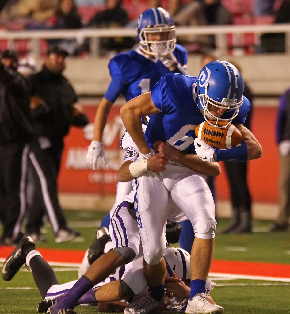 Dixie's  Jaden Harrison (6) breaks a tackle, Dixie vs. Tooele, 3AA Football Semifinals, Salt Lake City, Utah, Nov. 13th, 2015, | Photo by Robert Hoppie, ASPpix.com, St. George News