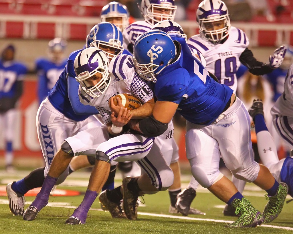 Dixie's Jeff Martinez (55) brings down the Tooele quarterback, Dixie vs. Tooele, 3AA Football Semifinals, Salt Lake City, Utah, Nov. 13th, 2015, | Photo by Robert Hoppie, ASPpix.com, St. George News