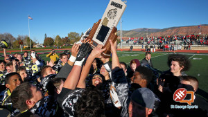The Diamond Ranch Diamondbacks hoist the state championship trophy, Diamond Ranch Academy vs. Kanab, 1A Football State Finals, Cedar City, Utah, Nov. 14th, 2015, | Photo by Robert Hoppie, ASPpix.com, St. George News