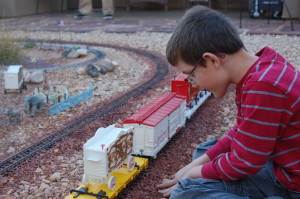 A young train enthusiast admires a model railroad display during the Model Train Home Tour, St. George, Utah, Nov. 13, 2015 | Photo by Hollie Reina, St. George News