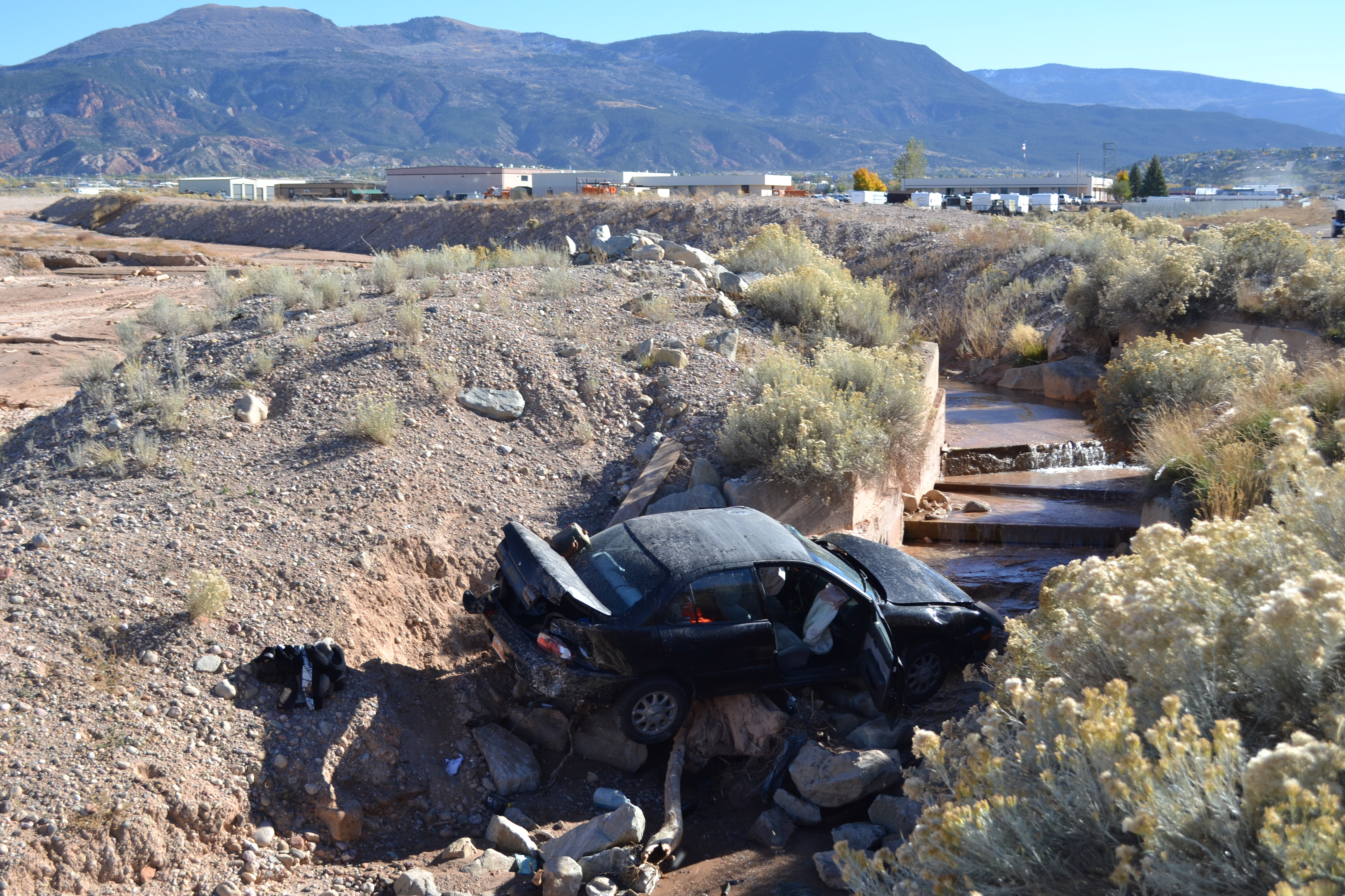 A woman reached for her phone while driving and crashed into a ditch, Cedar City, Utah, Nov. 2, 2015 | Photo by Emily Hammer, St. George News