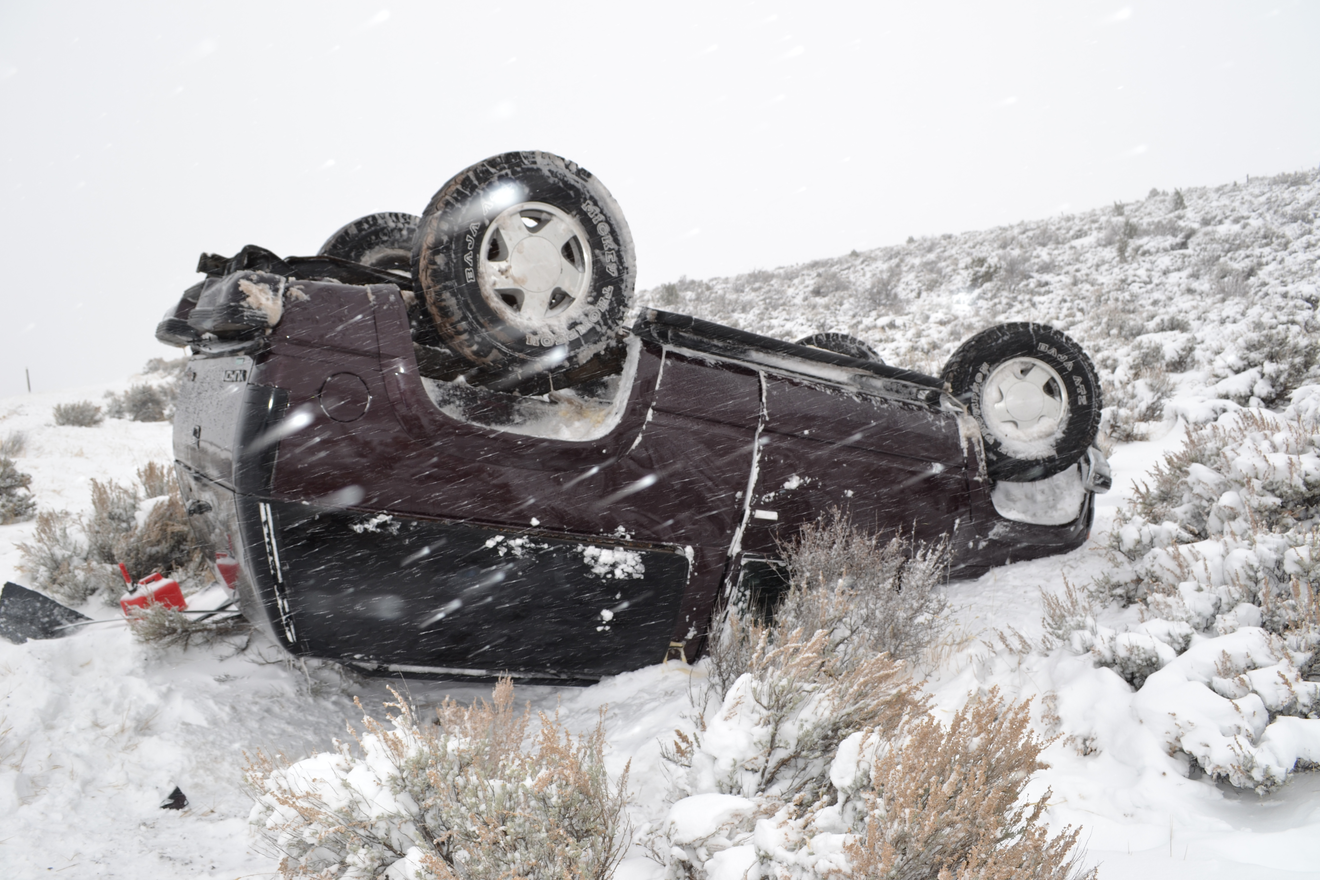 A car rolled on SR-130 in snowy weather, Nov. 16, 2015 | Photo by Emily Hammer, St. George News