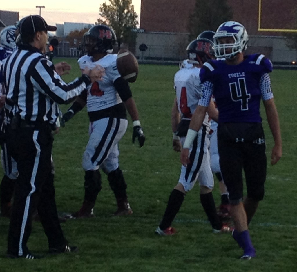 Tooele's Ryan Brady (4) tosses the ball to the referee after scoring on a long kick return, Hurricane at Tooele, Tooele, Utah, Nov. 6, 2015 | Photo by AJ Griffin, St. George News