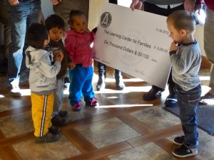 Representatives of the Associated General Contractors of Utah present a $6,000 donation to The Learning Center for Families, St. George, Utah, Nov. 30, 2015   Photo by Julie Applegate, St. George News