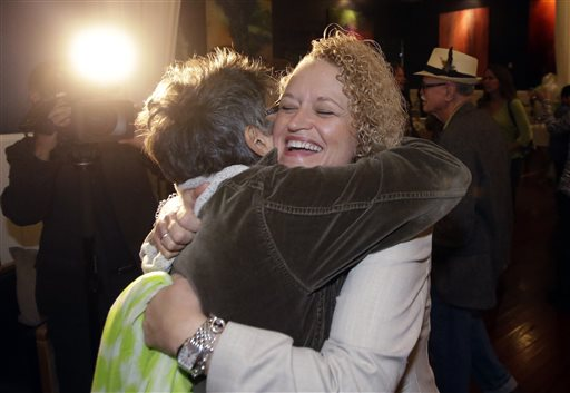 Former state lawmaker Jackie Biskupski, right, receives a hug from supporter Elise West at her election night party for Salt Lake City Mayor. Two-term Salt Lake City Mayor Ralph Becker hopes to beat back a challenge Tuesday from Biskupski as he seeks another term leading Utah's capital city. Salt Lake City, Utah, Nov. 3, 2015 | AP Photo by Rick Bowmer, St. George News